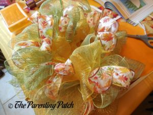 Adding Fall Leaves Ribbon to Deco Mesh and Ribbon Autumn Wreath Craft