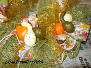 Decorating the Deco Mesh and Ribbon Autumn Wreath Craft