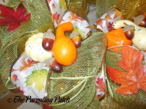 Gluing Decorations to Deco Mesh and Ribbon Autumn Wreath Craft