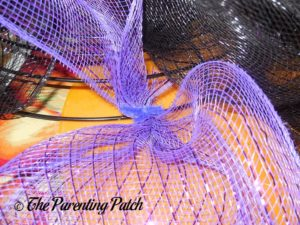 Adding Purple Deco Mesh to the Deco Mesh Halloween Wreath Craft