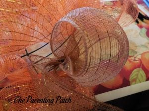 Adding Brown Deco Mesh to the Deco Mesh Indian Corn Autumn Wreath Craft