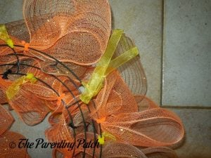 Adding a Ribbon Hanger to the Deco Mesh Indian Corn Autumn Wreath Craft