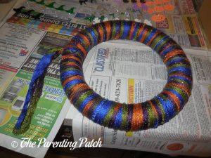 Wrapping More Yarn Around Halloween Ribbon and Yarn Wreath Craft