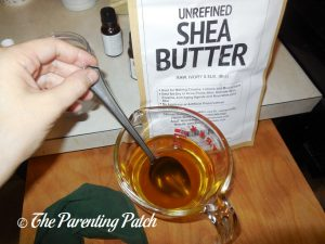 Stirring Essential Oil in Easy DIY Body Butter and Lip Balm