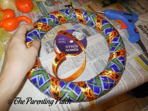 Wrapping Ribbon Around Duct Tape Halloween Wreath Craft