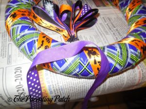 Gluing Ribbon Bow to Duct Tape Halloween Wreath Craft