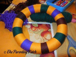Yarn-Wrapped Wreath for Halloween Yarn Block-Color Wreath Craft