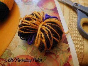 Tying Yarn Ball for Halloween Yarn Block-Color Wreath Craft