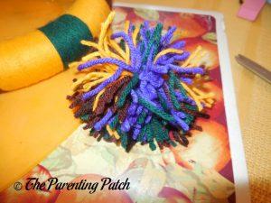 Cutting Loops of Yarn Ball for Halloween Yarn Block-Color Wreath Craft