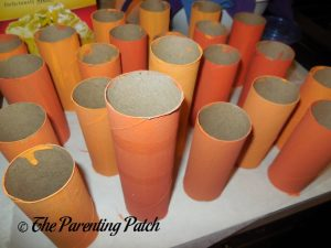 Painting Tubes Orange for Toilet Paper Tube Pumpkin Jack o' Lantern Craft