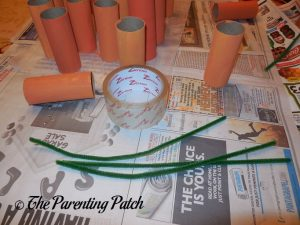 Cutting Green Pipe Cleaners for Toilet Paper Tube Pumpkin Jack o' Lantern Craft