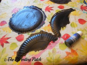 Painting the Plates Black for the B Is for Bat Paper Plate Craft