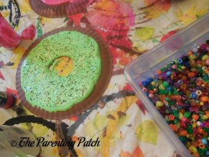 Sprinkling Beads on the D Is for Donut Paper Plate Craft
