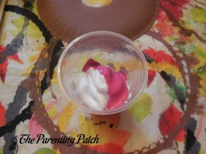 Mixing the Puffy Paint for the D Is for Donut Paper Plate Craft