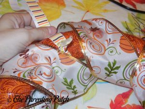 Adding the Ribbon Hanger to the Duct Tape and Ribbon Autumn Wreath Craft