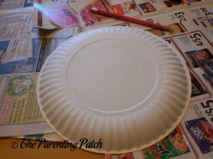 Drawing a Spiral for the G Is for Ghost Halloween Paper Plate Craft