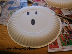 Drawing a Ghost Face for the G Is for Ghost Halloween Paper Plate Craft