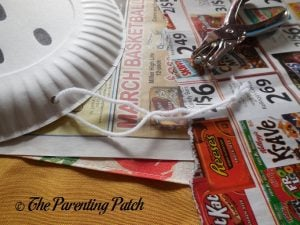 Making a Yarn Tie for the G Is for Ghost Halloween Paper Plate Craft