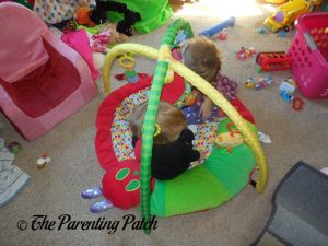 Kids Playing on The Very Hungry Caterpillar Activity Gym with Musical Mobile