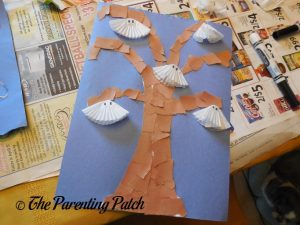 Gluing Ghosts on Torn Paper and Cupcake Liner Halloween Ghost Tree