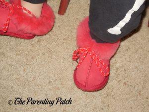 Toddler Wearing Cool Beans Red Sheepskin Winter Slipper Boots 1