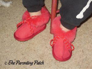 Toddler Wearing Cool Beans Red Sheepskin Winter Slipper Boots 2