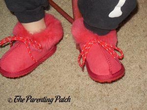 Toddler Wearing Cool Beans Red Sheepskin Winter Slipper Boots 3