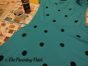 Painting Black Dots on the Sally Brown Costume