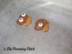 Adding Candy Eyeballs to the Chocolate Dipped Pretzels