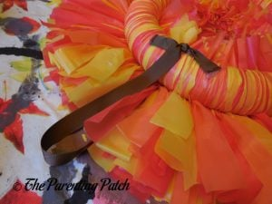 Tying a Yarn Hanger to the Tablecloth Ribbon Thanksgiving Wreath Craft