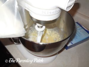 Adding Cake Mix to Wet Ingredients for the Christmas Sprinkle Cake Cookies