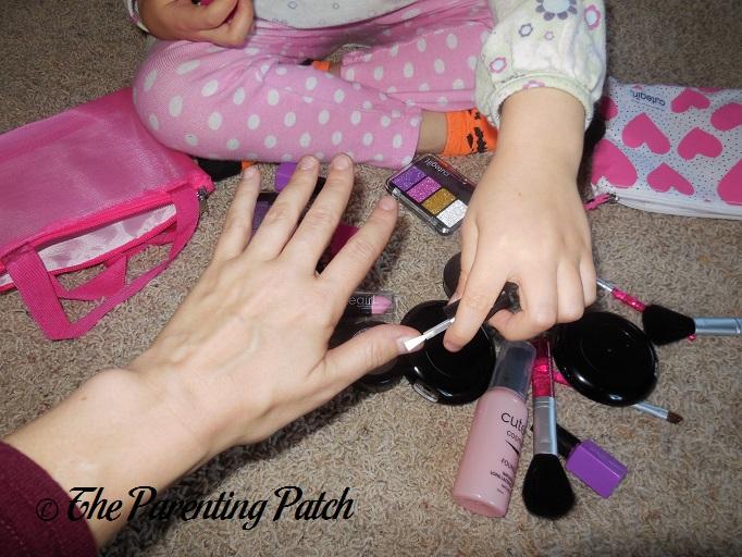 Fixing her nail polish - 3 3