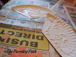Gluing Orange Squares on the Pumpkin Pie Paper Plate Craft