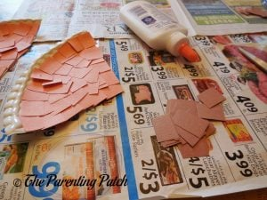 Cutting Brown Squares for the Pumpkin Pie Paper Plate Craft
