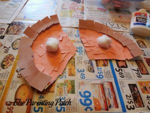 Finishing the Pumpkin Pie Paper Plate Craft