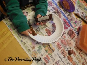 Stamping the Paper Plate Ring Brown 1