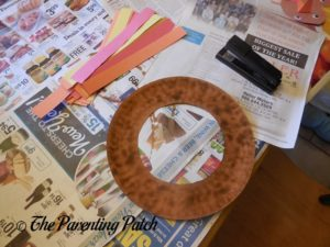 Cutting Red, Orange, and Yellow Paper Strips for the Turkey Paper Plate Wreath Craft