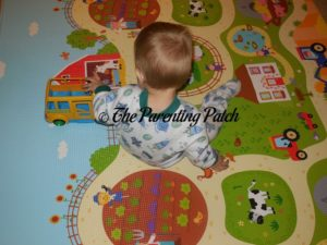 Toddler Playing on Baby Care Large Busy Farm Foam Play Mat