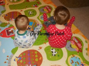 Toddler and Kindergartener Playing on Baby Care Large Busy Farm Foam Play Mat