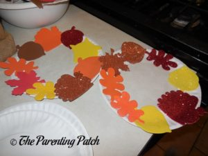 Gluing Large Foam Shapes on the Paper Plate Thanksgiving Wreath Craft