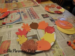 Gluing More Large Foam Shapes on the Paper Plate Thanksgiving Wreath Craft
