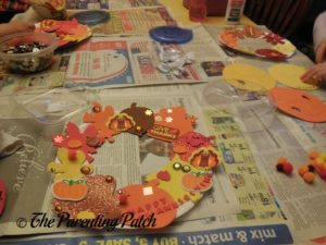 Decorating the Paper Plate Thanksgiving Wreath Craft