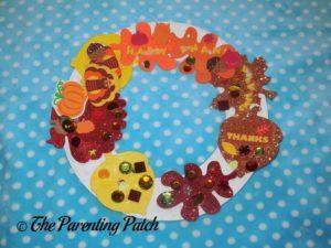 Paper Plate Thanksgiving Wreath Craft by Kindergartener