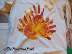 White Shirt with Red and Yellow Handprints