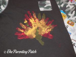 Brown Shirt with Red and Yellow Handprints