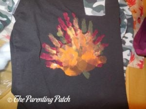 Brown Shirt with Red, Yellow, and Orange Handprints