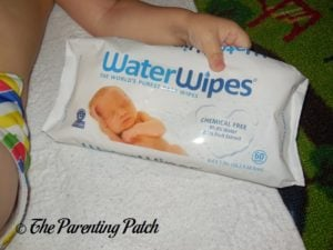 Toddler Holding WaterWipes Package