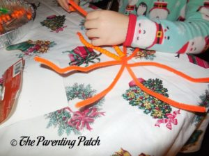 Twisting Together Pipe Cleaners for Pony Bead Pumpkin Craft