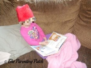 Poppy Reading 'My Christmas Sing-Along Book' from I See Me! 1