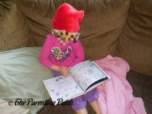 Poppy Reading 'My Christmas Sing-Along Book' from I See Me! 2